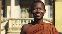 Happy buddhist monk smiling in temple, Cambodia, Asia. With Model Release Stock Footage
