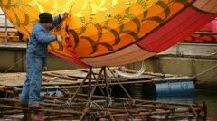 Craftsman Building A Big Dragon Lantern Stock Footage