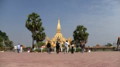 Timelapse of Pha That Luang temple in Vientiane Laos Stock Footage