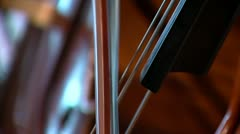 Cello extreme close up and tilt to hands Stock Footage