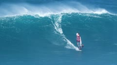 Maui, hi - march 13: professional windsurfer robby naish rides a giant wave a Stock Footage