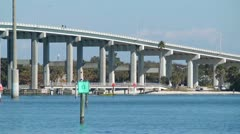Time Lapse close up tall bridge traffic with boat traffic Stock Footage