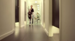 Girls are going to try on clothes in a store  (fitting room) Stock Footage