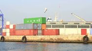 Cargo containers in sea port Stock Footage