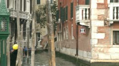Boat trip through Venice passing stakes Stock Footage