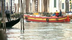 Postman on a boat in Venice Stock Footage