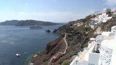Cruiseship leaves the volcanic caldera on the Greek island of Santorini, Greece Stock Footage