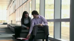 Business people looking at paperwork in conference center - stock footage