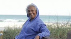 Senior African American woman at beach Stock Footage