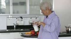Senior African American woman applying hand lotion - stock footage