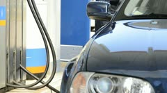 Worker at gas station; Full HD Photo JPEG - stock footage