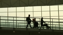 Silhouettes of Family Travellers in Airport Stock Footage