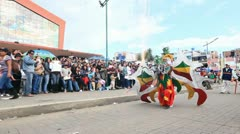 PILLARO, ECUADOR - 1 JANUARY 2012: Persons disguised as devils dancing on the Stock Footage