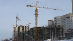 Winter construction. With the boom of a crane. Ufa, Russia, building site Stock Footage