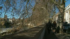 Walkers along the Tiber in Rome (glidecam) 1 minute moving shot Stock Footage