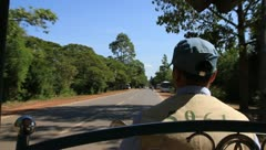 Tracking shot of Tuktuk driver around Angkor Wat Stock Footage