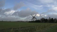 Working dutch windmill - long shot Stock Footage