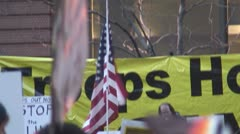 American flag at Iraq War protest in Federal Plaza - Chicago, IL Stock Footage