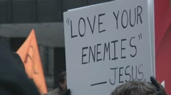 """'Love Your Enemies' - Jesus"" protest sign Stock Footage"
