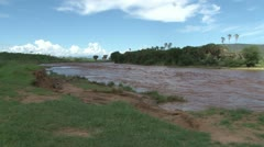 Zoom in of a swollen river. Stock Footage