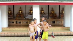 Children and Golden Buddha Statues Stock Footage