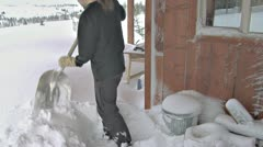 Shoveling Snow Off deck After Blizzard Stock Footage
