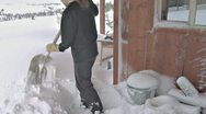 Stock Video Footage of Shoveling Snow Off deck After Blizzard