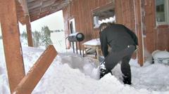 Shoveling Snow Drift Off Deck After Blizzard 2b Stock Footage
