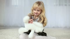 Child playing with a teddy bear Stock Footage