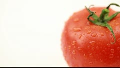 Drops of water on tomato Stock Footage