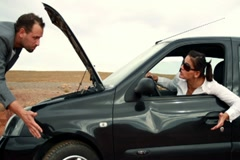 Business couple having fight by the broken car NTSC widescreen - stock footage