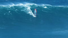 Maui, hi - march 13: professional windsurfer jason polakow rides a giant wave Stock Footage