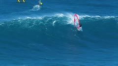 Maui, hi - march 13: professional windsurfer jason polakow rides a giant wave Stock Footage