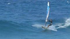 Maui, hi - march 13: professional windsurfer mark angulo rides a large wave. Stock Footage