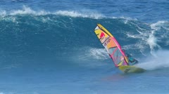 Maui, hi - march 13: professional windsurfer kai lenny rides an ocean wave. m Stock Footage
