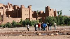 Tourist group by the Aït Benhaddou in Morocco HD Stock Footage
