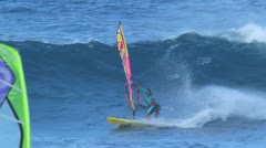 Maui, hi - march 13: professional windsurfer kai lenny rides an ocean wave. m Stock Footage