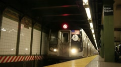 New York City Subway train coming and leaving station track Stock Footage