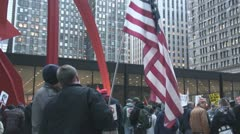 American Flag holder at Iraq War protest in Federal Plaza - Chicago, IL Stock Footage