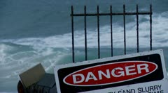Danger Sign, Surf in background Stock Footage