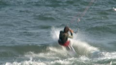 Kiteboarder does aerial jump and flip Stock Footage