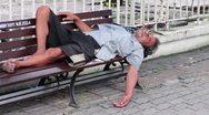 Homeless man sleep on bench Stock Footage