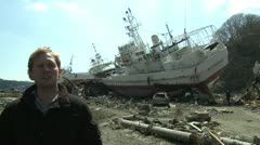 Reporter Files Story In Japan Tsunami Disaster Zone Stock Footage