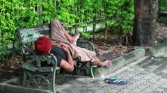 homeless man sleep on bench - stock footage
