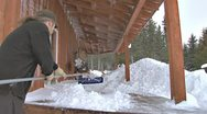 Stock Video Footage of Clearing snow from deck after Blizzard with Snow rake
