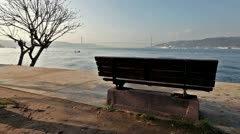 Bench on the shore of bay Stock Footage