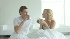 Couple drinking tea at bed - stock footage