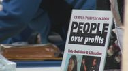 Stock Video Footage of 'People Over Profits' at Iraq War protest in Federal Plaza - Chicago, IL