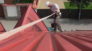 Worker on a roof Stock Footage