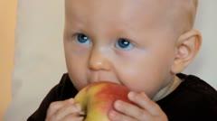 Boy eats apple Stock Footage